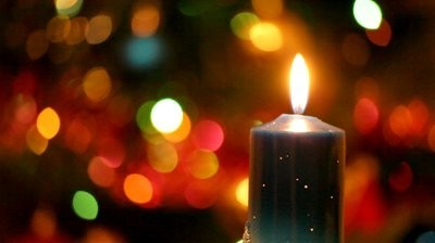 stock-footage-christmas-candle-against-s