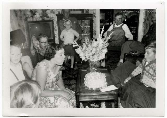 family-blowing-out-candles-1950s.jpg
