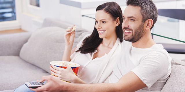 happy-couple-watching-movie.jpg
